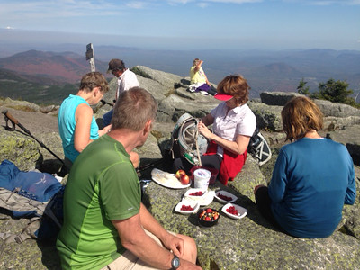 Steve, Sue, Marian with snacks and Joan on Whiteface Summit